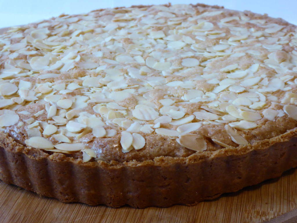 Bakewell tart with lemon pastry before cutting