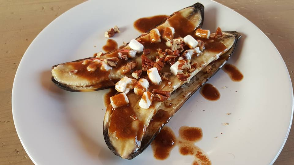 Grilled banana boats with pecans, marshmallow and a gooey Cadbury Creme Egg ganache