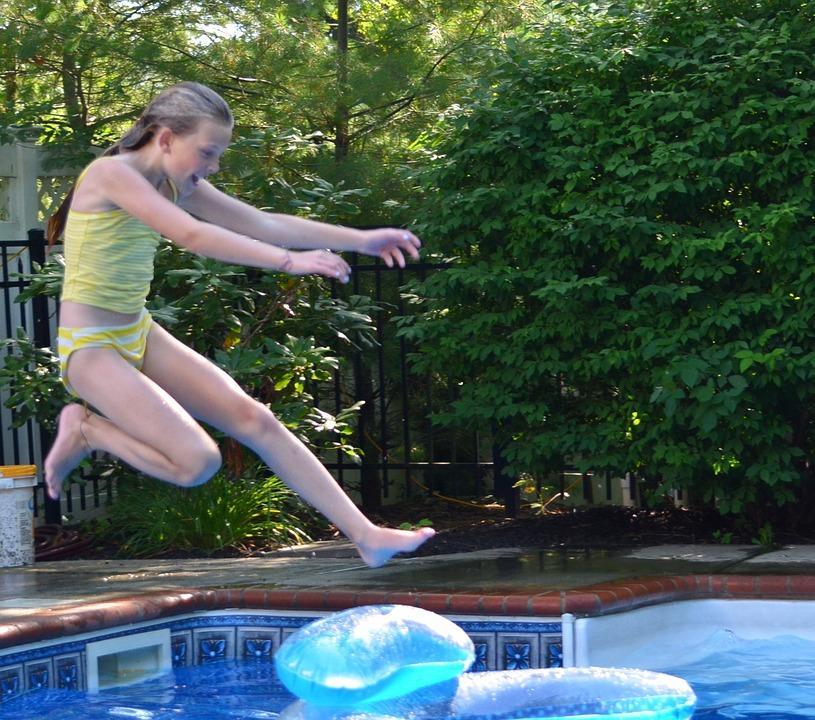 swimming pool, girl jumping in swimming pool