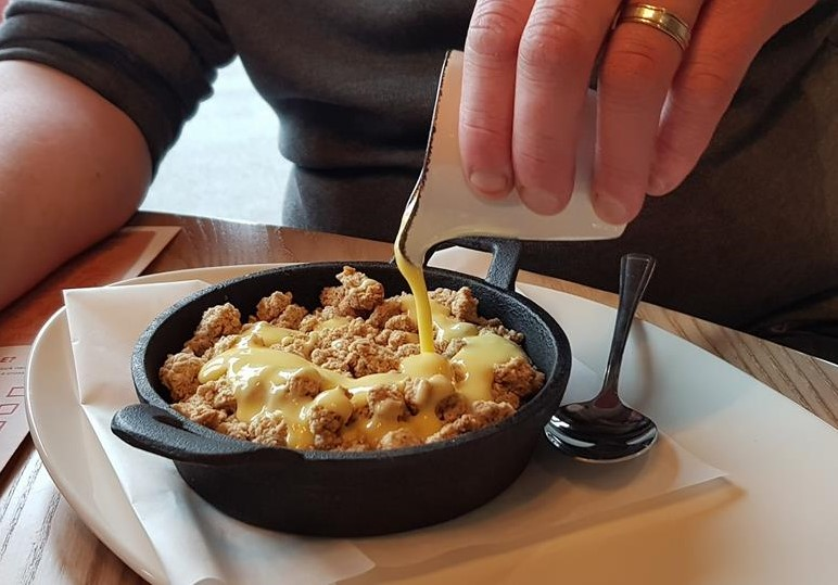 Apple crumble with custard dessert