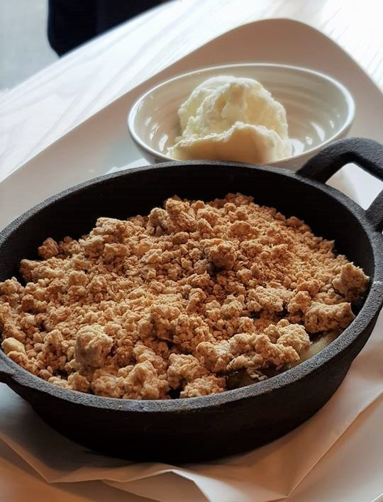 Apple crumble with ice cream dessert