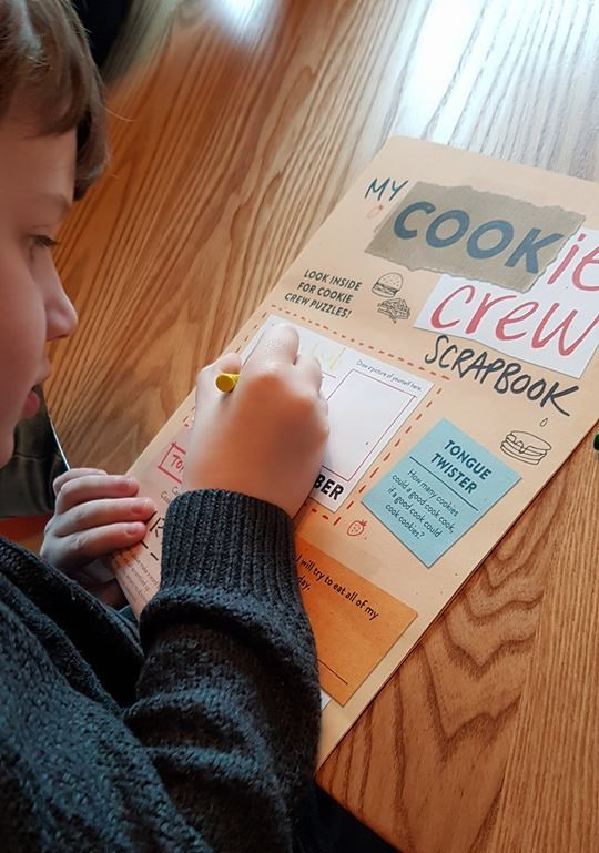 Jacob doing activity book