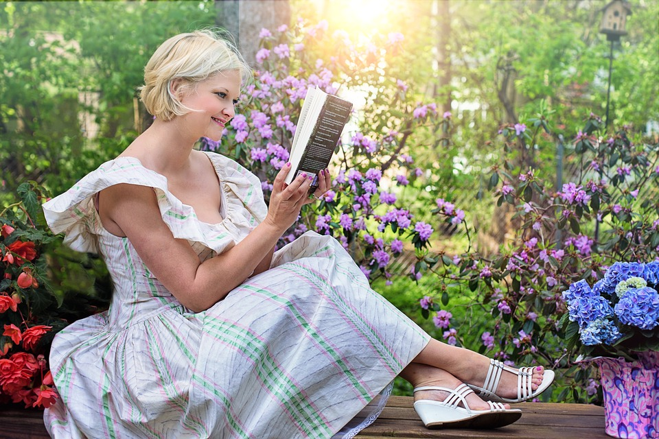 woman reading in garden