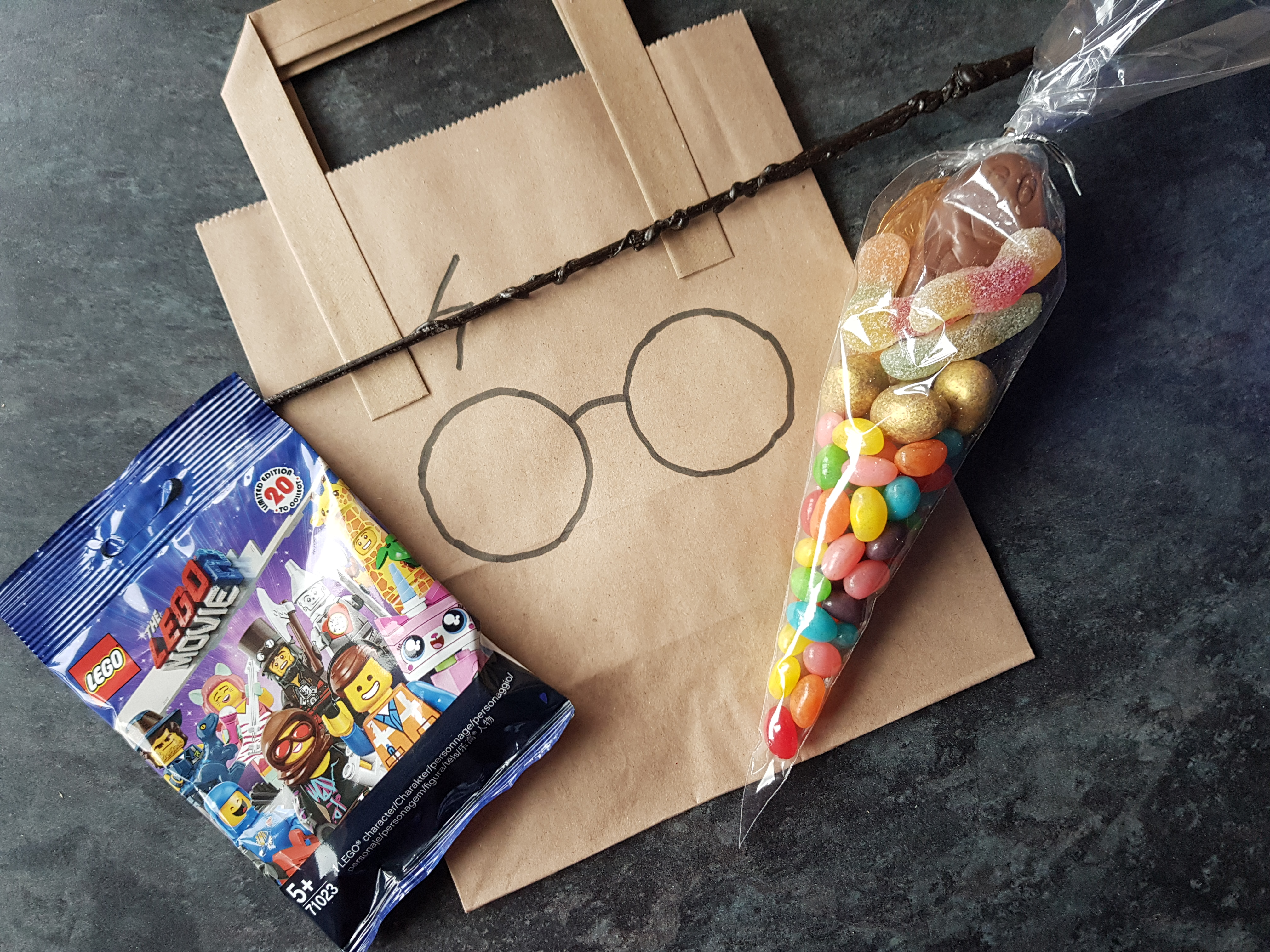 Party bag contents, Lego minifigure, wand, sweet cone