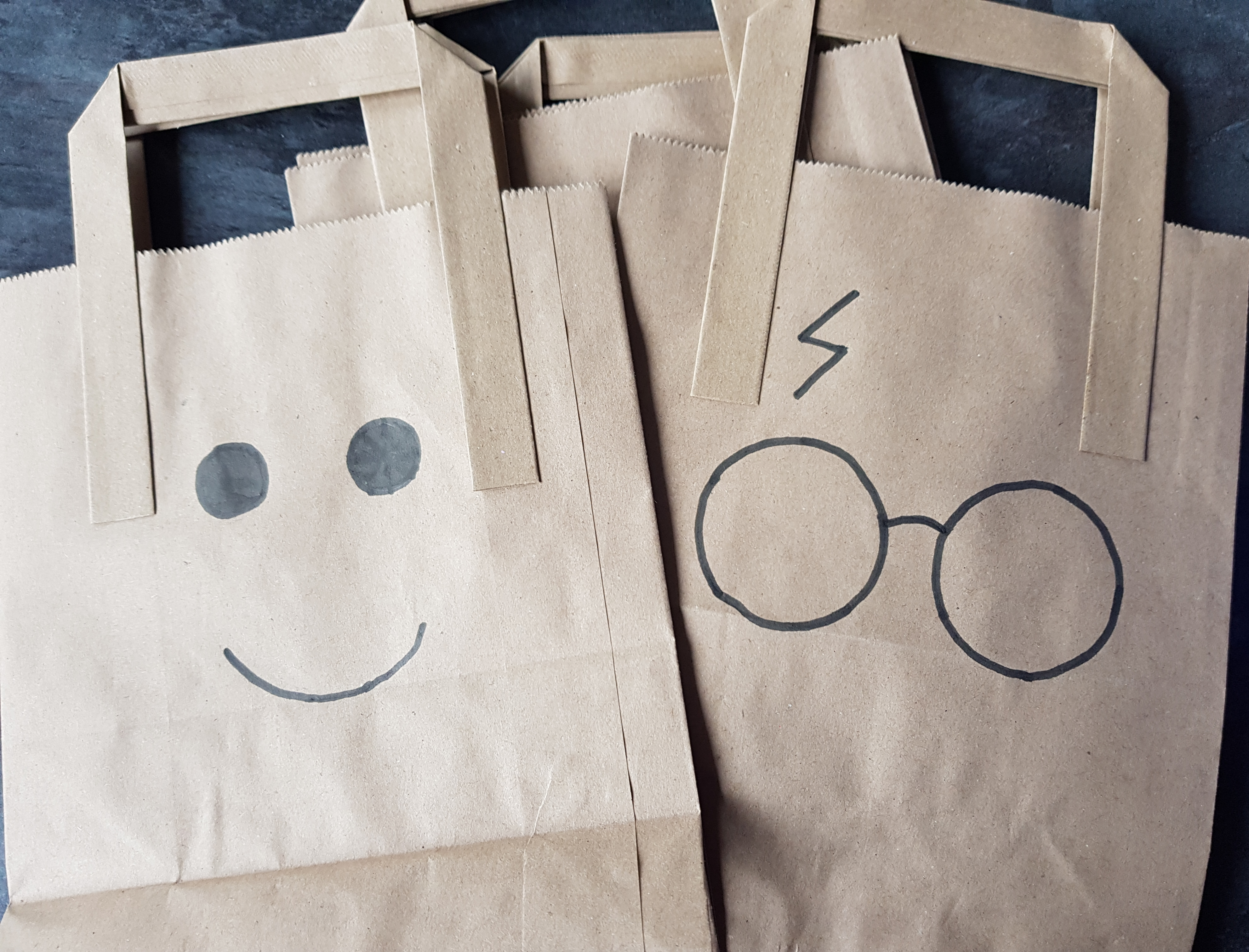 Lego face and Harry Potter glasses and scar party bags