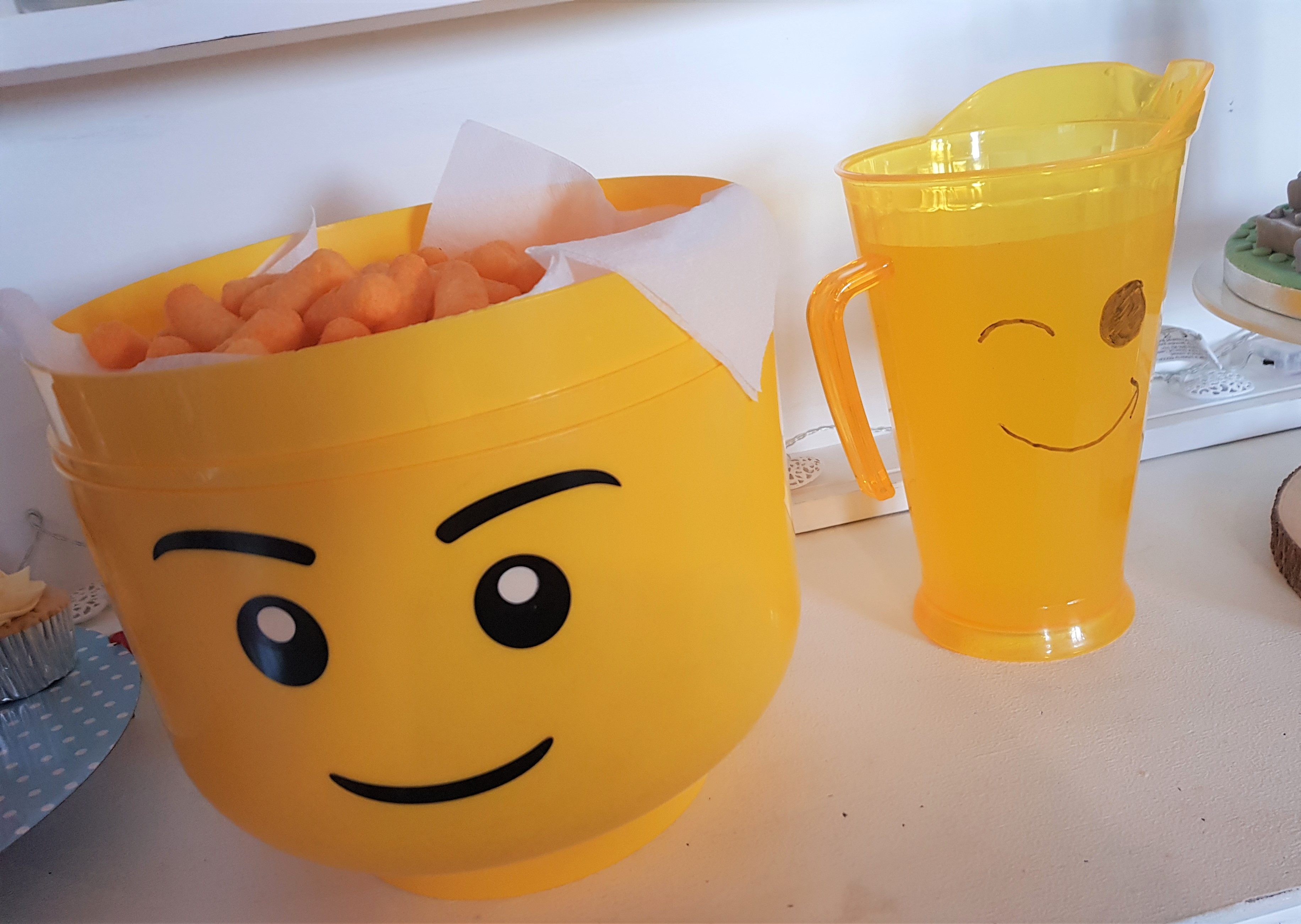 Bertie Lego head, lego face drawn on yellow jug