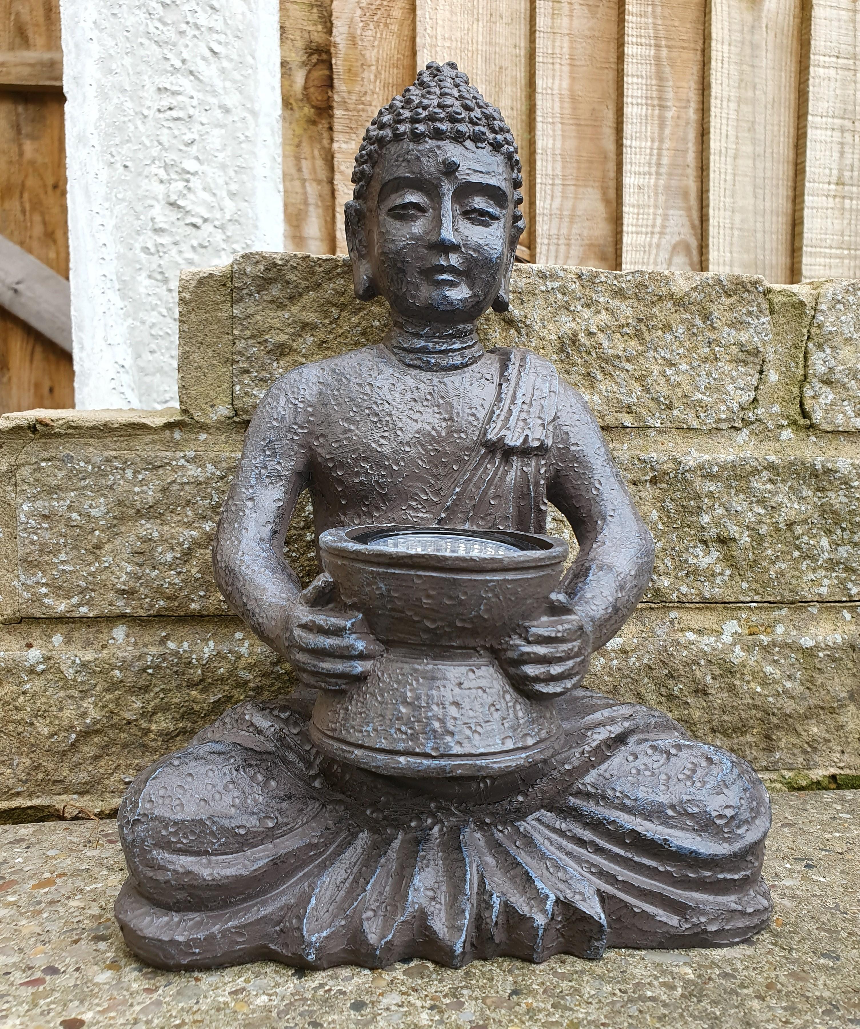TJ Hughes solar buddha