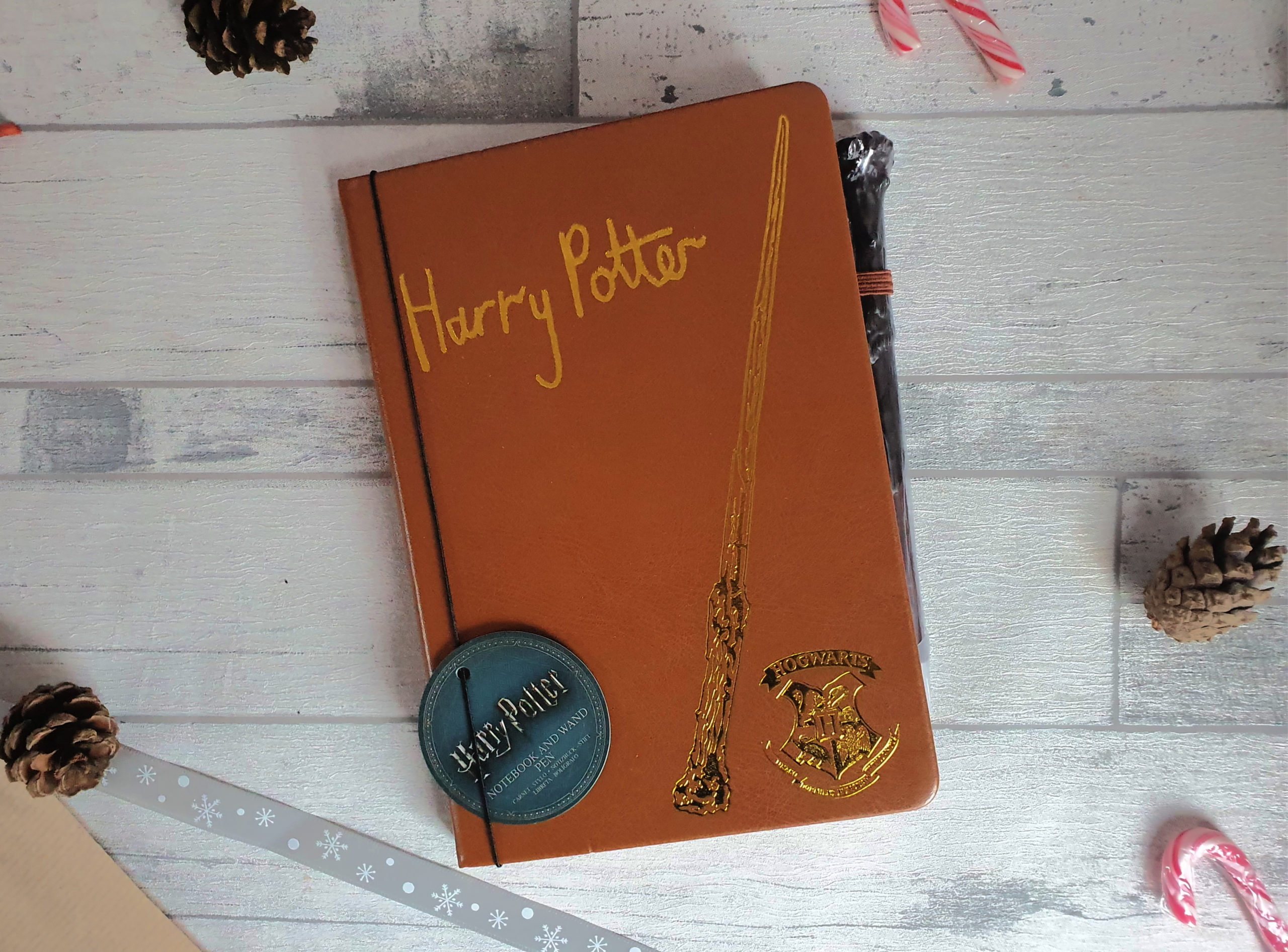 Notebook and wand pen, Harry Potter written on the front