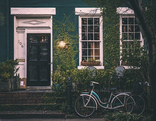 house with ivy covering the walls and a bicycle in front, How To Add Value To Your Property When You Are Selling Up