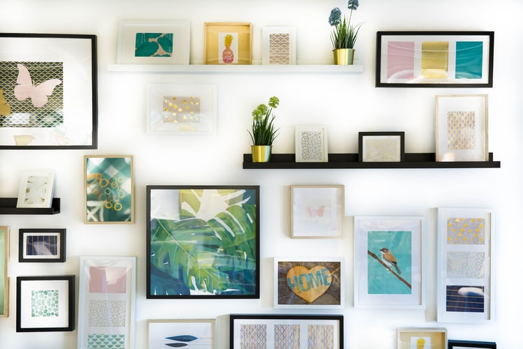 variety of framed images on a white wall