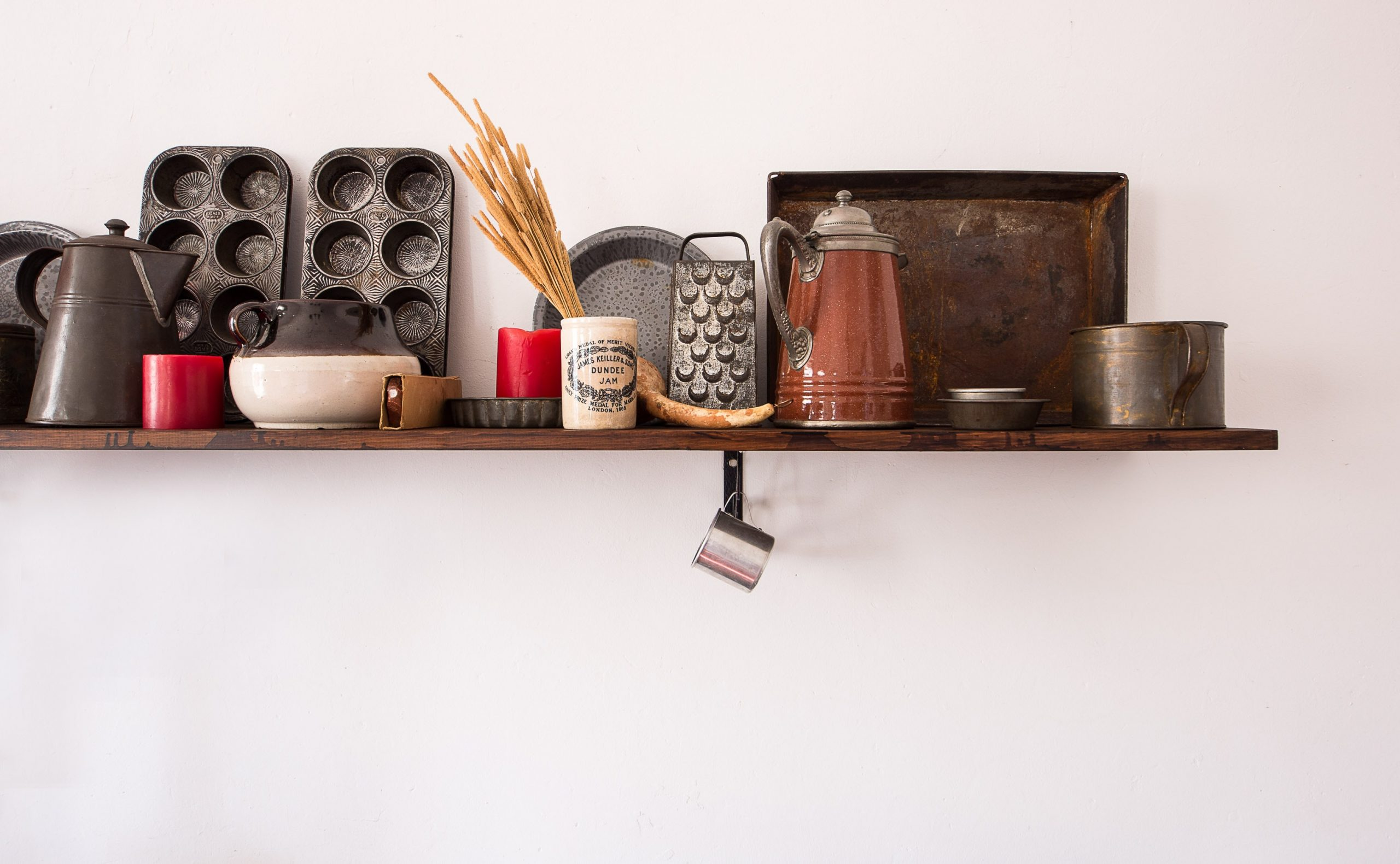 kitchen shelf packed with old farmhouse kitchen utensils, Creating Farmhouse Chic With Your Interior
