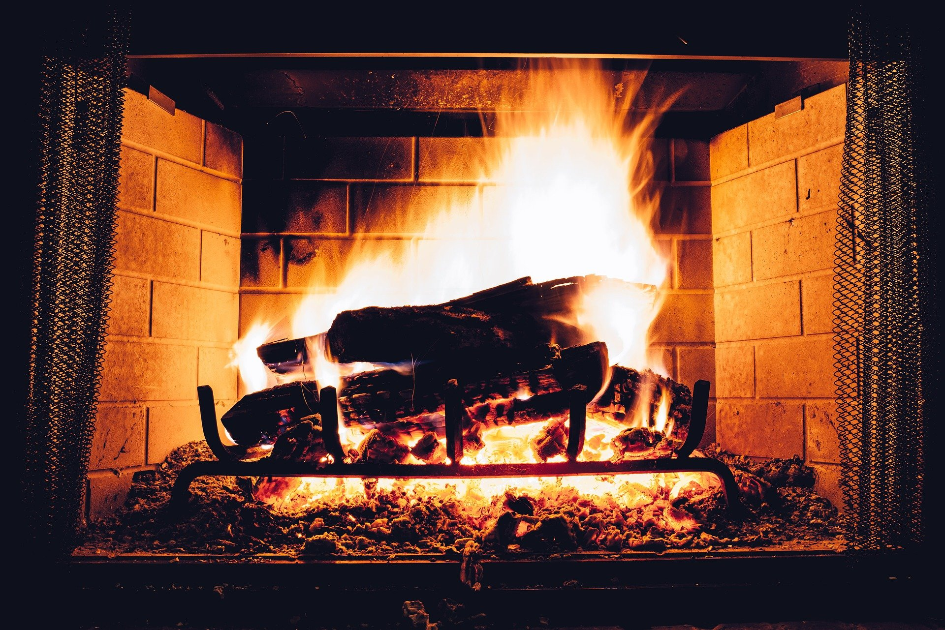 roaring fireplace, The 4 Best Ways to Keep Your Home Warm This Winter