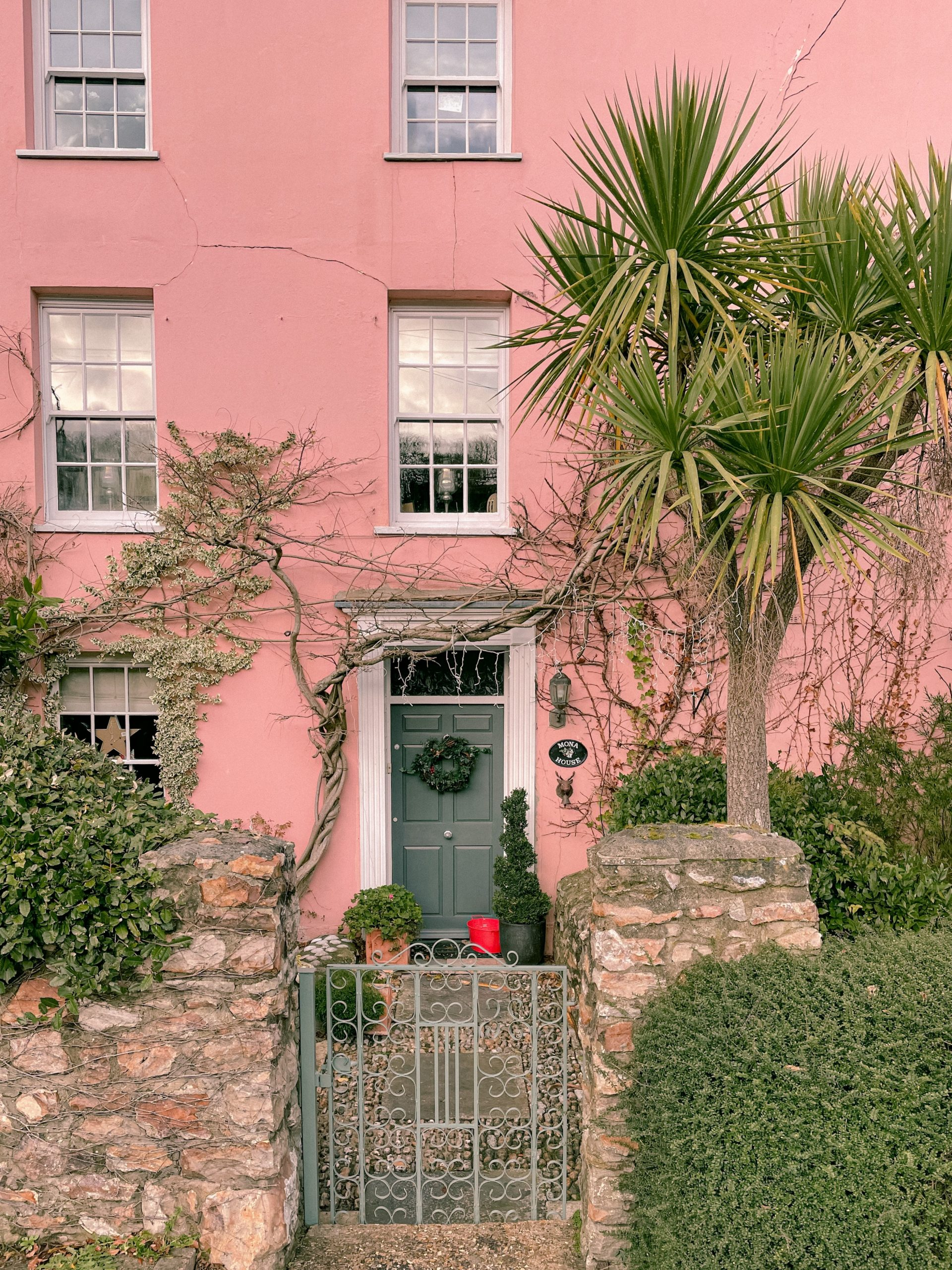 front of a house painted pink; 7 Decorative Ideas For Your Front Garden