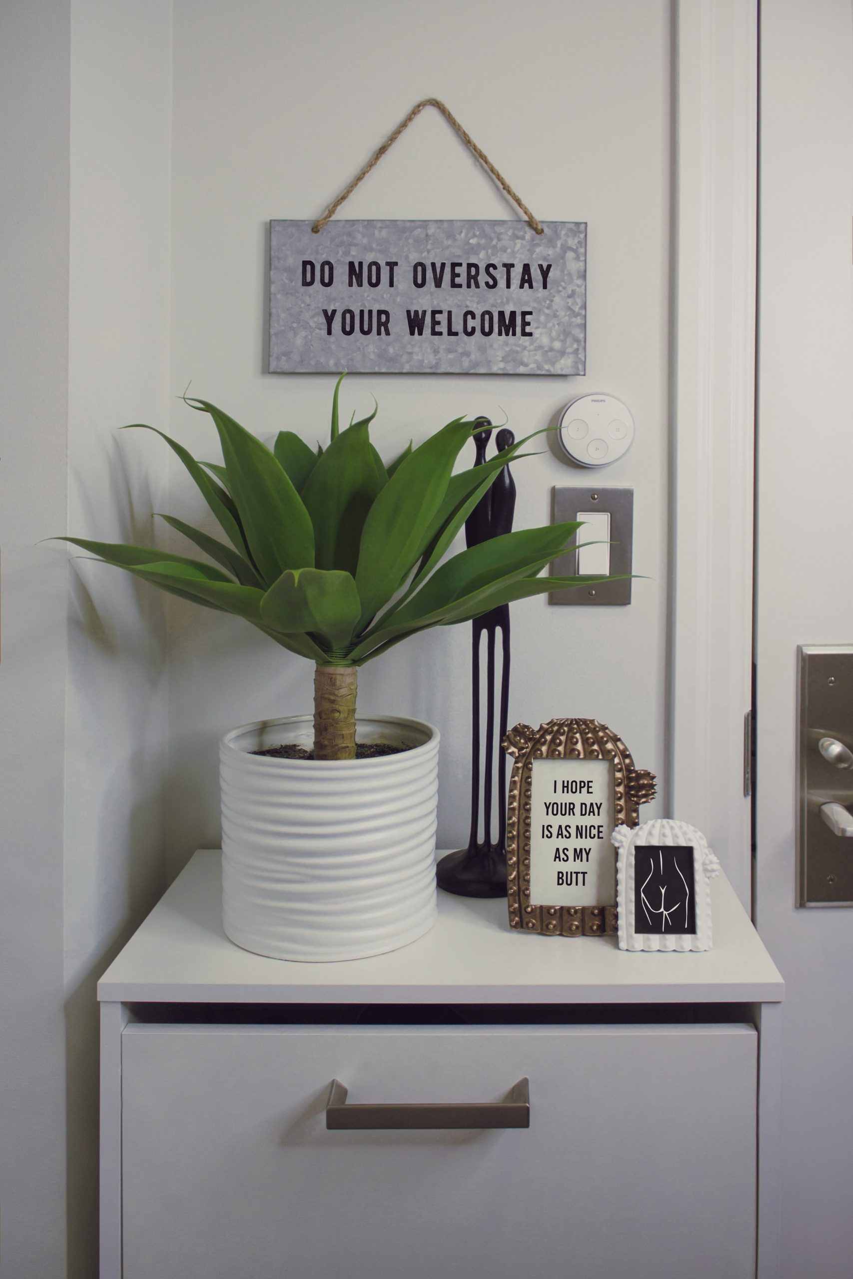 indoor plant surrounded by quote pictures; Easy Ways to Update Your Home Decor
