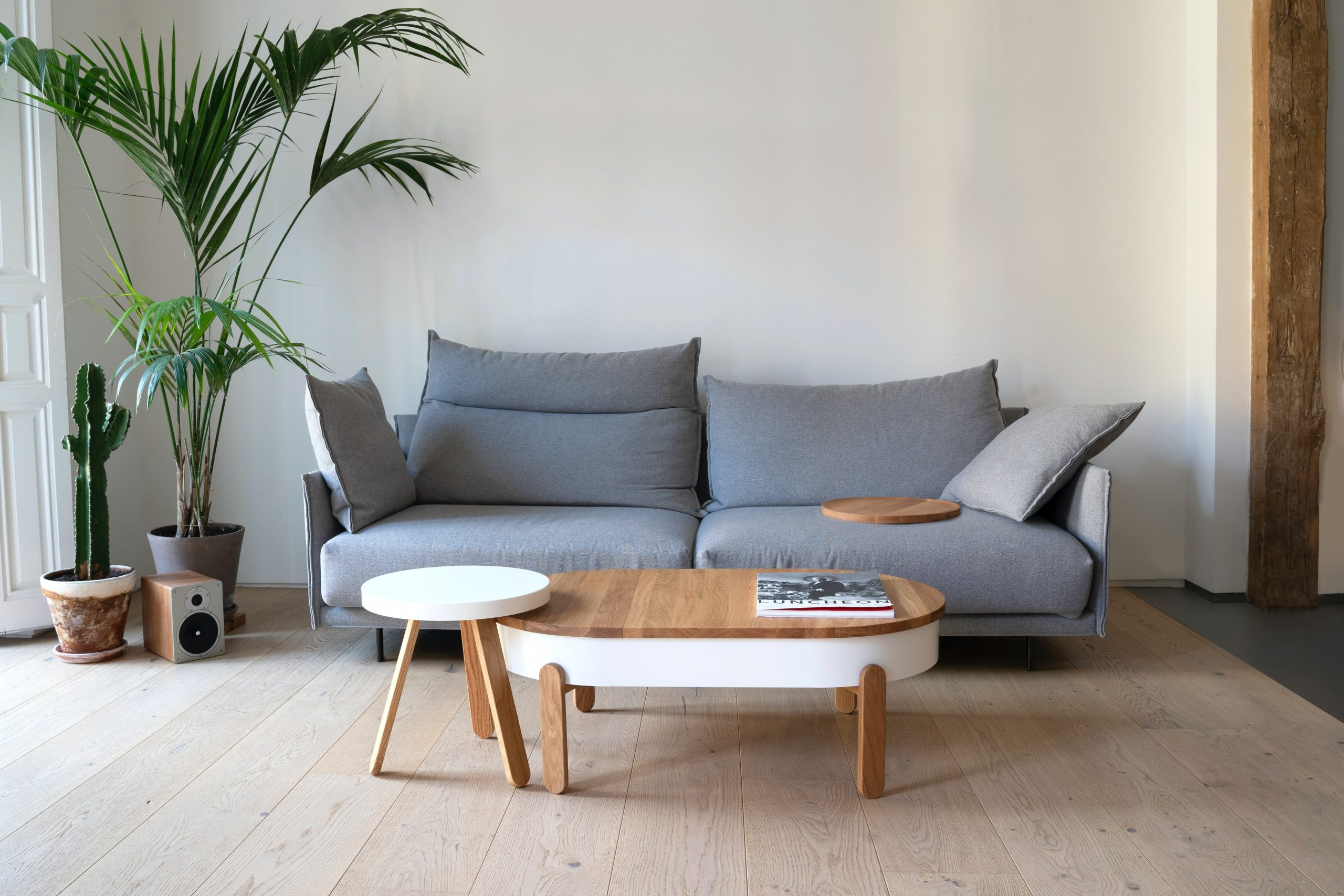 wooden coffee table in front of a grey sofa, Small Budget Redecoration Ideas That Look Amazing
