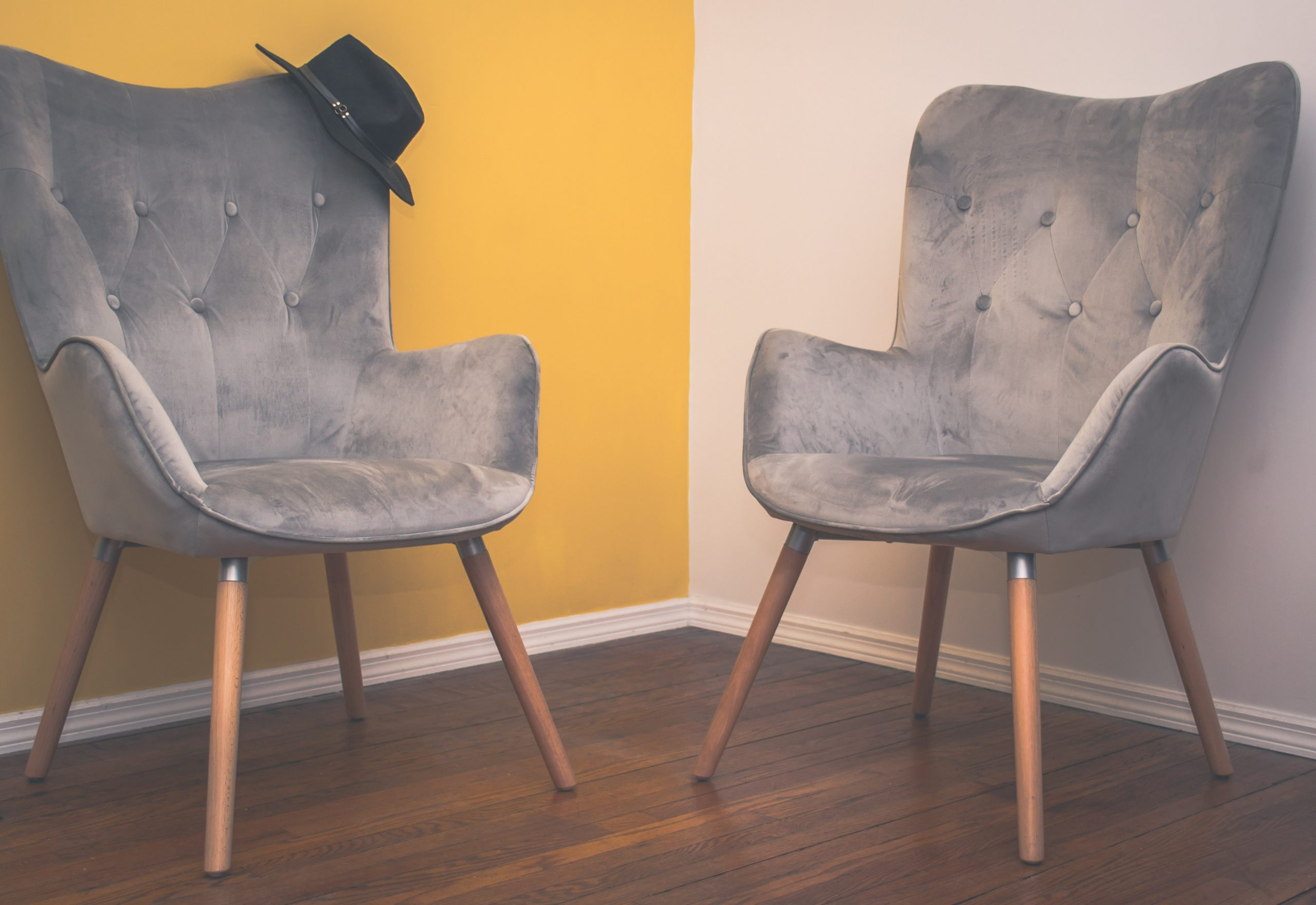 two soft grey chairs in minimalist room