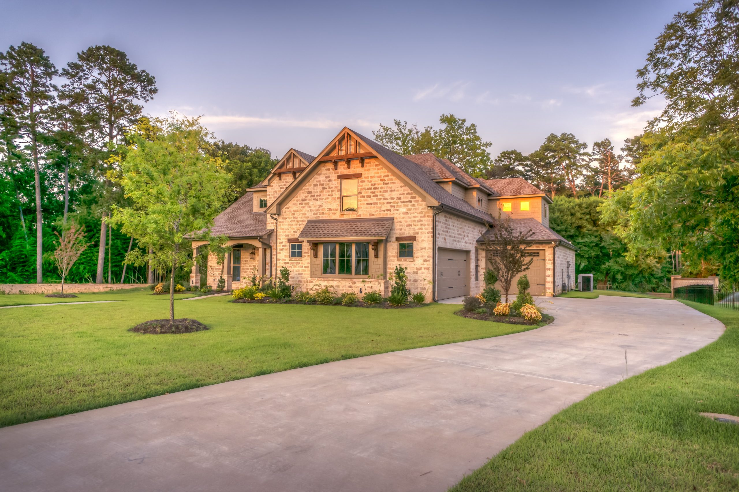 large brown house at the end of a long drive; Try These Landscaping Ideas to Maximize Your Home's Kerb Appeal