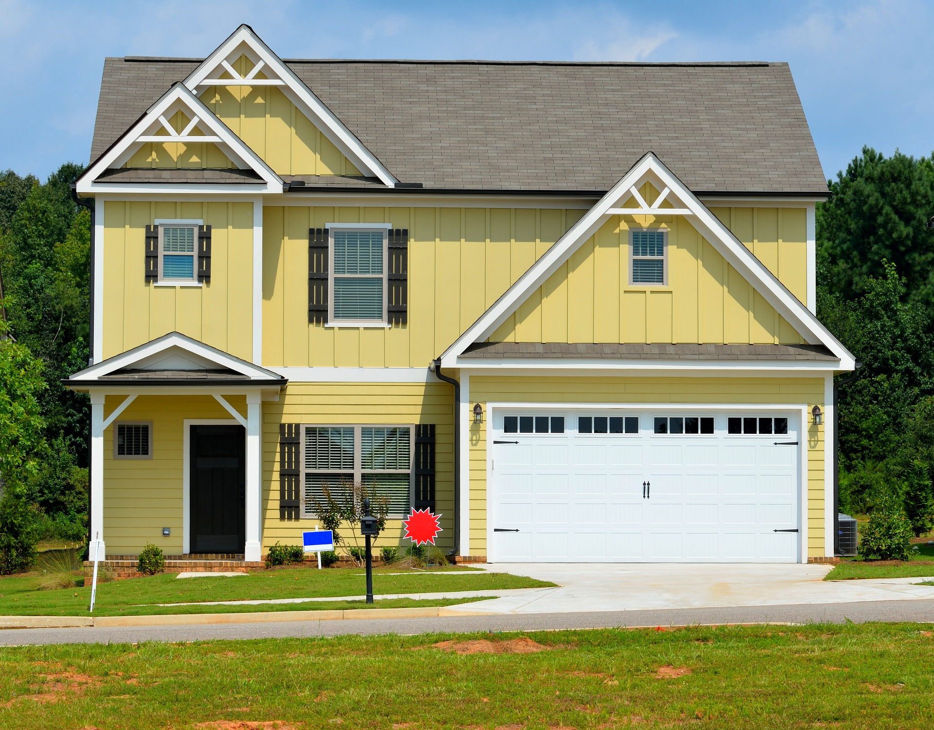 yellow house with sale signs; Short Guide To Make Your House Move Easy