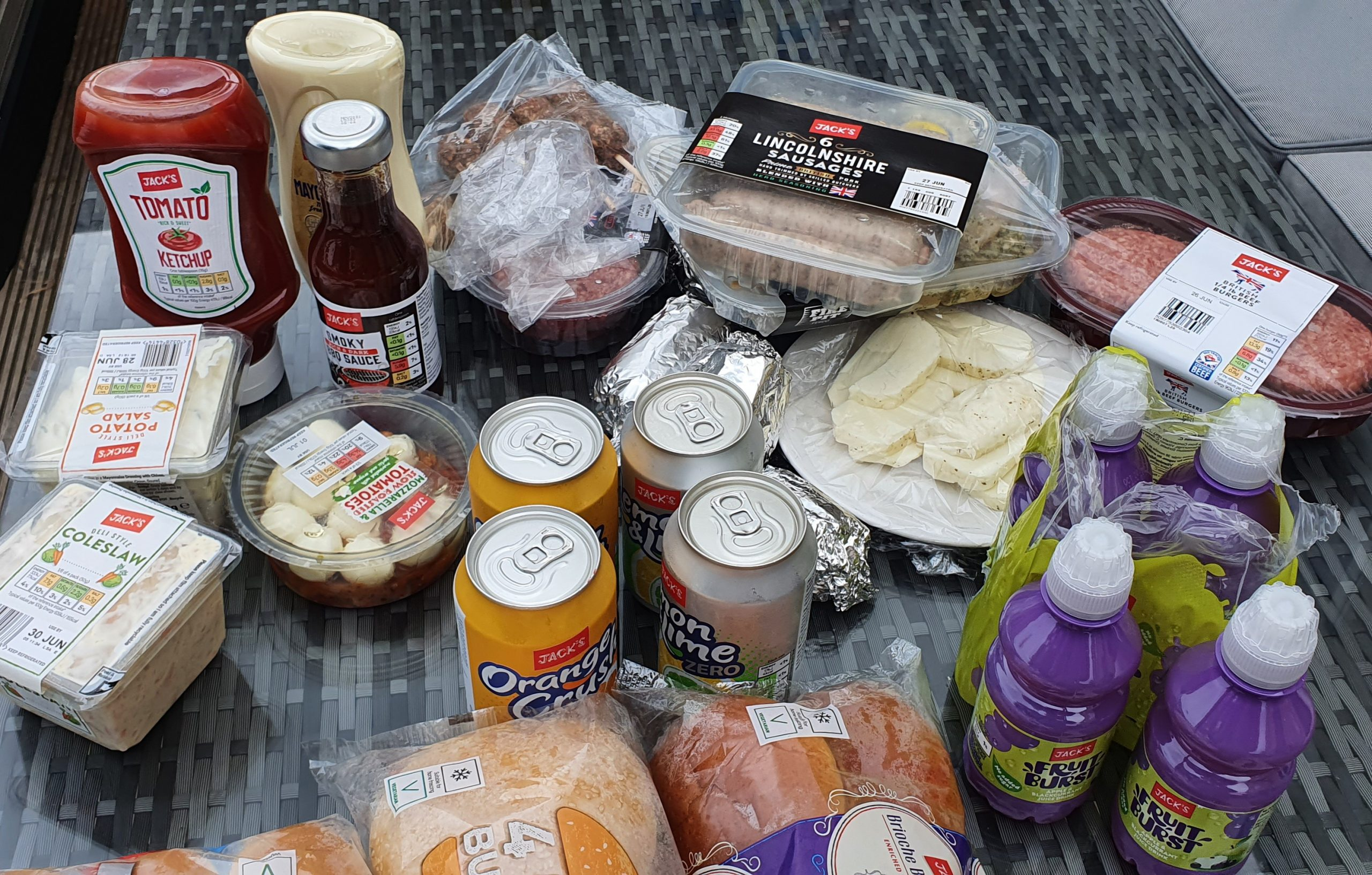 a table of food ready to eat at a barbecue