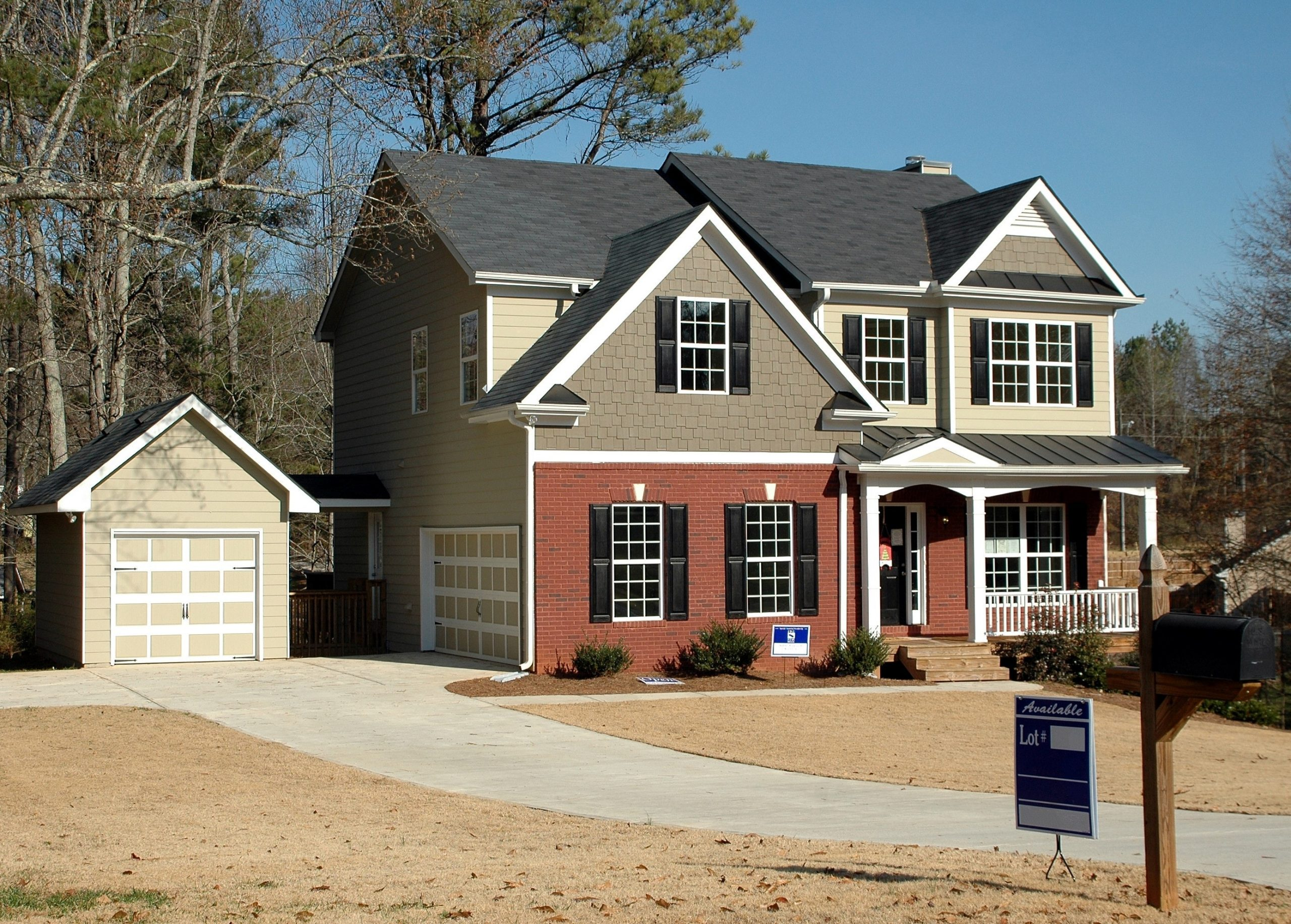 the front of a large house with a sale sign; Selling Your Home At The Right Price Is Easy When You Know How