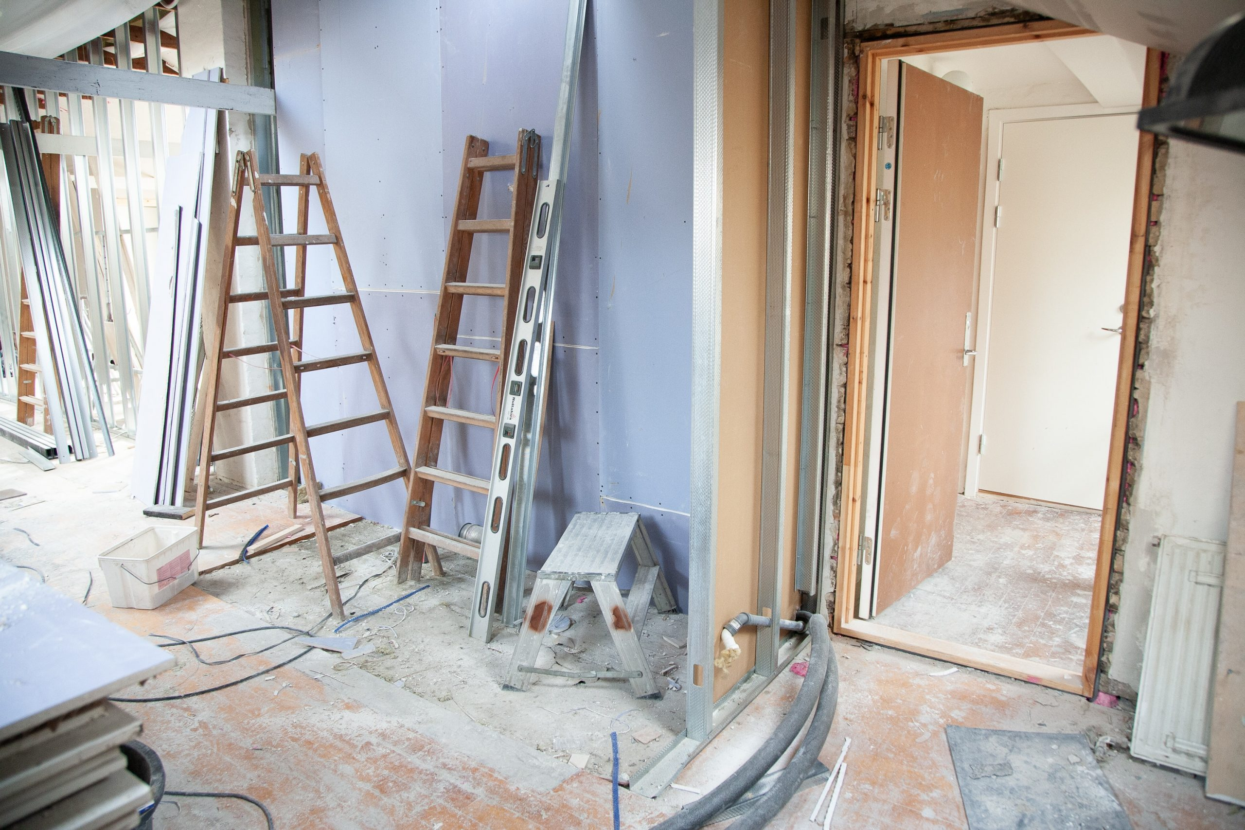 two pairs of step ladders in a room renovation; Considering Home Renovations 4 Tips on How To Prepare