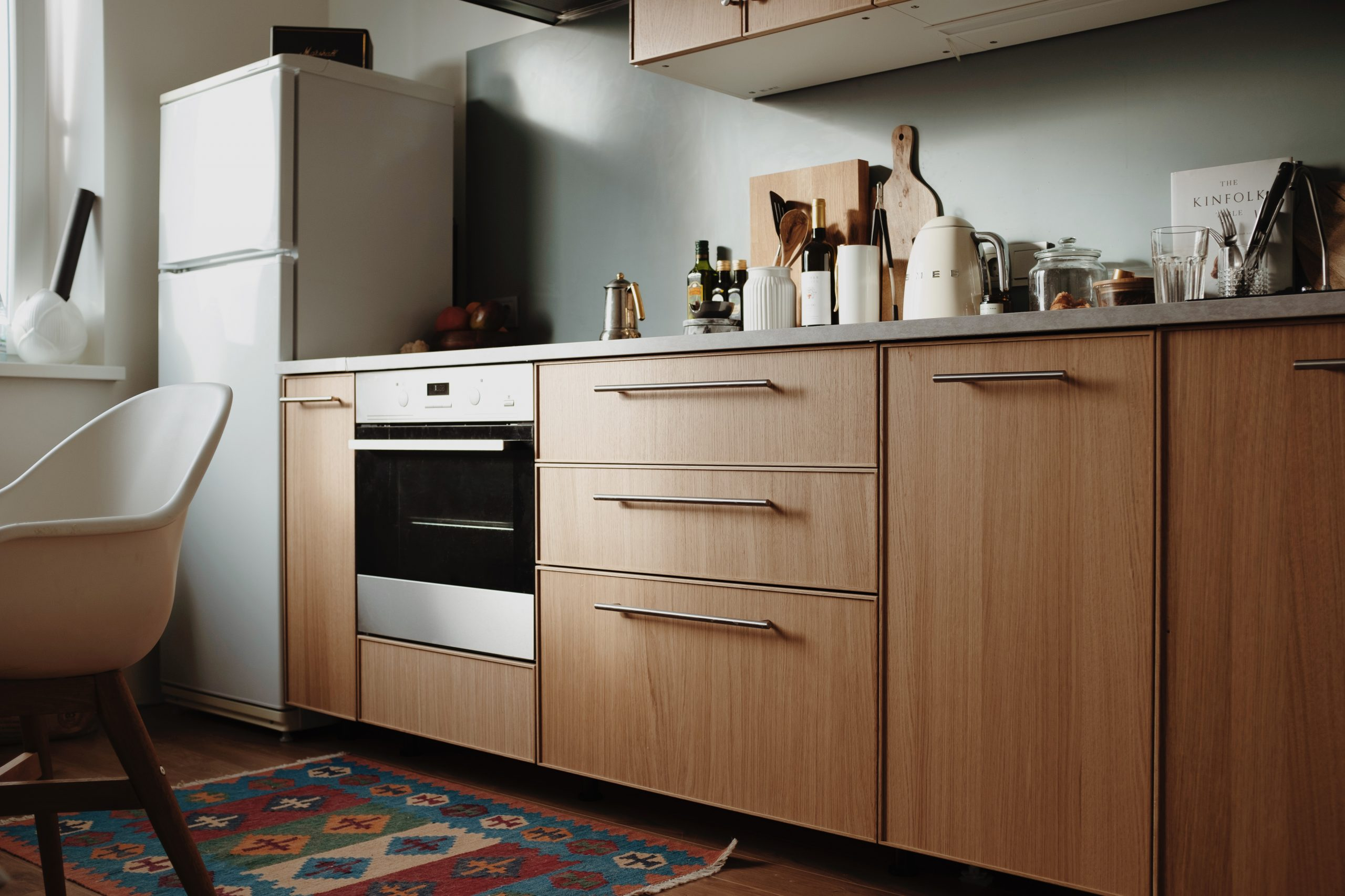 a kitchen sideboard with light brown cupboards and drawers, and a built in oven; 5 Sure Signs It's Time To Remodel Your Kitchen